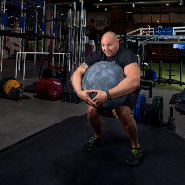 Strong Man, Strongman Strongman Trainer, Strong man, Strongman, Powerlifting, Power Lifting, Powerlifting Classes, Powerlifting Class, Strongman - Fly High Fitness